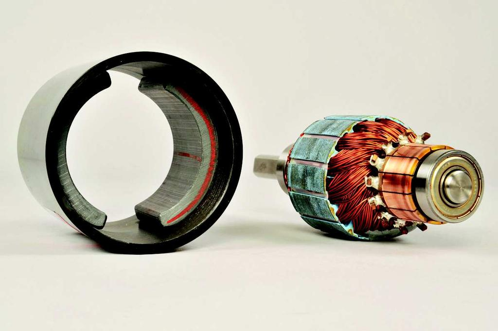 The stator consists of a pair of permanent magnets aligned so that poles of opposite polarities face each other.