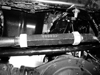 SUSPENSION DISASSEMBLY 7. Support the front axle with a hydraulic jack. 8.