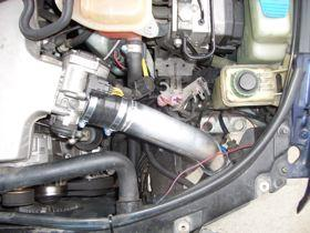 21) If you re-use the stock power-steering cooler, you can carefully bend it over your leg to give it a curve.