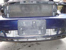 9) Back to the front bumper of the car, it is necessary to remove the aluminum support beam from the plastic cover.