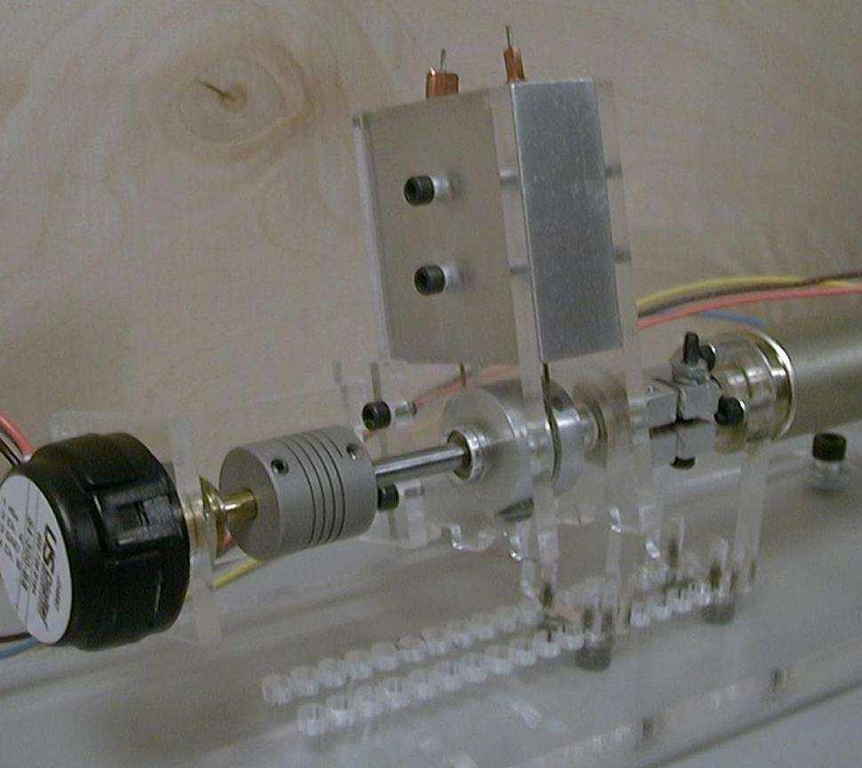 2R Locking Force L - Xi + X L - Xi - X F2 Figure 5: Actuator configuration with applied force holding it in place. Figure 7: A testing prototype of the actuator made of acrylic and aluminum.
