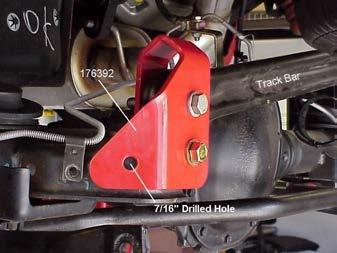Illus. 28 4) Tighten the 9/16 bolt to 77 ft. lbs. and the 7/16 bolt to 45 ft. lbs. Do not tighten the original track bar bolt until the vehicle is at normal ride height.