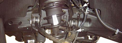 NOTE: For vehicles equipped with Autoride (Electronic Suspension Control), separate brake hose from sensor link bracket. 2) Remove the brake caliper anchor bolts.