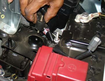 Loosen the air duct clamp from the throttle body