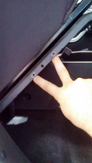 Figure 3 2-E) For 2013+ Jeeps, simply use a ¼ drill to drill out the two existing holes on the outer side seat frame rail as shown