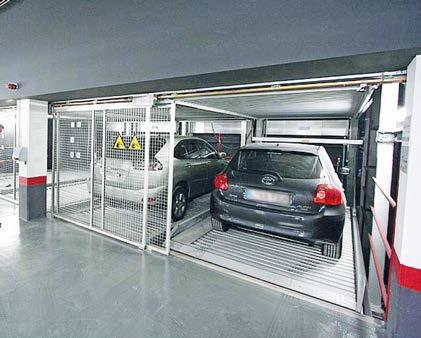 UNIPARKER N5403 on 3 levels Parking system with 2 Levels in the pit Modular construction expandable at will Lower level with lifting platforms, entrance level with sliding platforms, two empty spaces