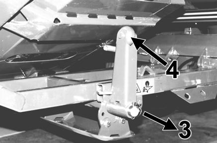 4. Turn the support arm through 90 degrees (pointing upwards) and push the support arm back into place. Secure it with the large linch pin. 5. Lower the bale damper cradle plate down again. 6.