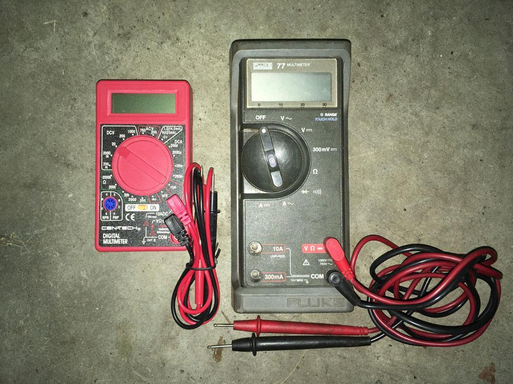 The Harbor Freight $5.99 multimeter (left) does not have autoranging, and consequently, its center selection dial is cluttered with options.