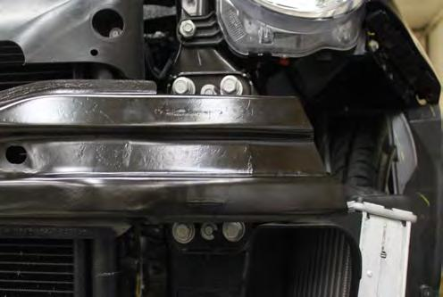7. Using a 15MM socket, remove the four (4) larger bolts from bumper (white).