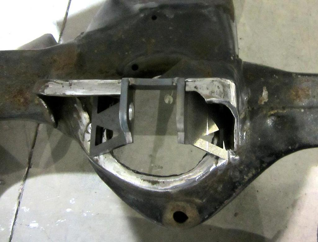 6. For 68-72 cars, skip step 6 and proceed to step 7. On 64-67 cars mark the width of the shock bolt area of the bracket on the upper control arm mount.