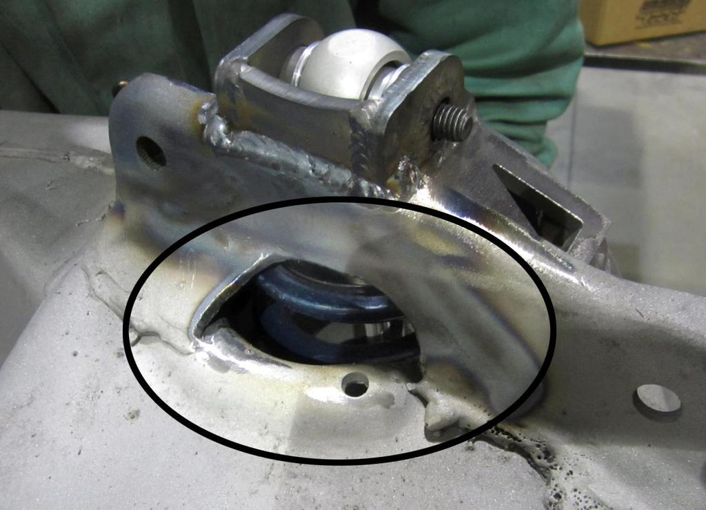 11. Depending on shock and spring combination, on some frames, it may be necessary to clearance the inner section of the control arm mount as seen in the photo below.