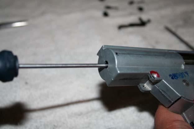 Slide a small screwdriver into the back of the mechbox and push down to take up the spring tension.