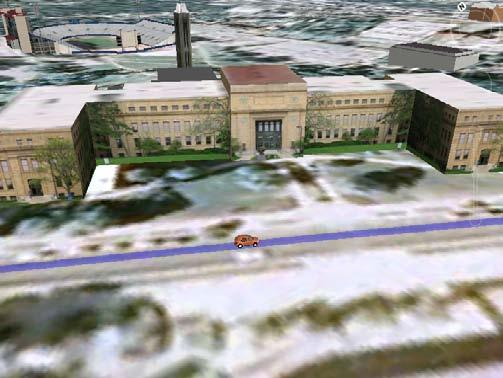 Figure 3 above shows a vehicle travelling on a route through the University of Kansas, where 3-d images of campus buildings designed by users of Google Earth can be seen.