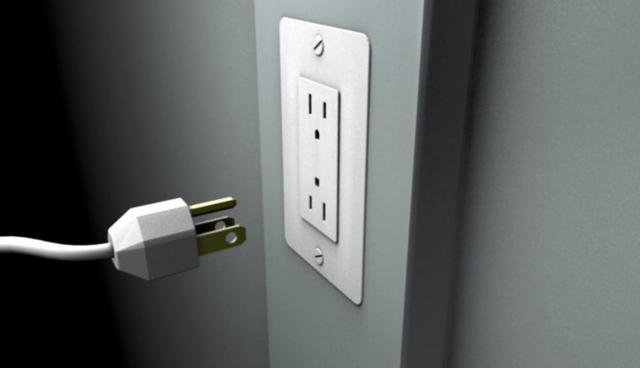 Wall Socket Has a voltage difference across the two holes of an