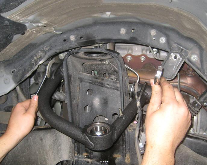 Do not tighten at this point. Repeat procedure on the passenger side. 10. Locate the new upper control arms.