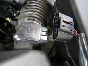 Make sure vehicle is parked on level surface. b. Set parking brake. c. If engine has run in the past two hours, let it cool down. d. Disconnect negative battery terminal. e. Raise the front of the vehicle with a jack.