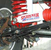 "Use the 1/2"" x 2 1/2"" flat socket head bolt & stover nut to bolt the new Skyjacker bracket to the track bar."