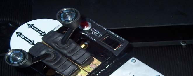 The control is located by the P.T.O. switch to the right of the driver (Ref.