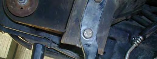 Loosen only the two bolts securing the stabiliser bars to the bumper,