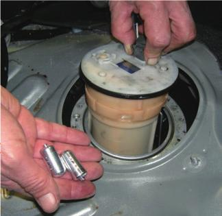 Remove the access plate and remove the pump / sender unit (Pic3). Drop the fuel sensor into the tank.