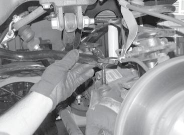 Remove the steering stabilizer frame bracket and save the hardware. Discard the frame bracket. Leave the steering stabilizer connected to the drag link. SEE FIGURE 3 2.