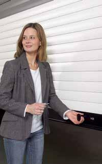 The manually operated roller garage door is mechanically locked using interior and exterior handles and a lock.