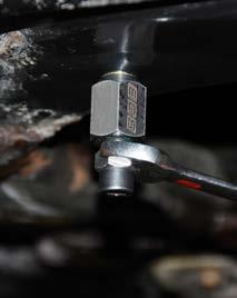 unthread the center screw from the riv-nut and remove the tool.