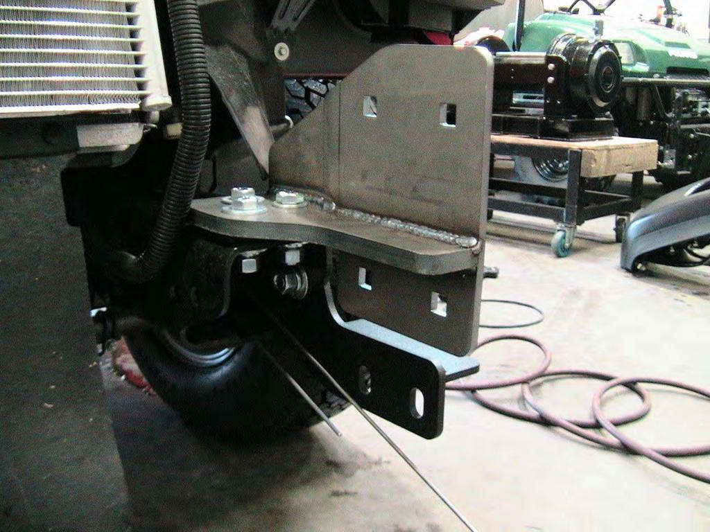 2. Install the outer frame bracket to both sides of the vehicle. See Figure 2 and 3. Use the supplied 5/8 hardware.