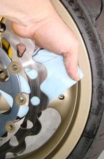 21. Using brake or contact cleaner and a rag, clean both sides of the rotors to insure that you