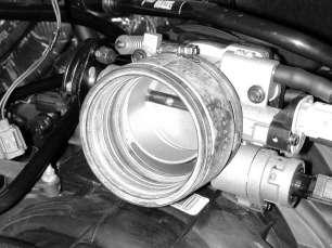 Remove the breather hose from the tee near the back of the intake manifold.