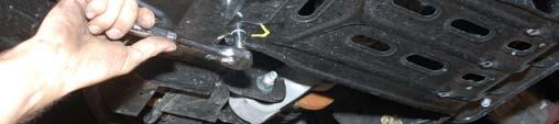 Using a 21mm socket remove the brake