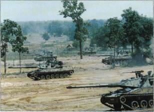 LIGHT TANKS AND MAIN BATTLE TANKS a Marconi Digital Fire Control System for improved first round hit probability.
