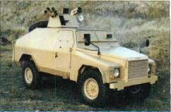 Shorland Armoured Patrol Car (UK/Australia) AKEY RECOGNITION FEATURES Land Rover chassis with armoured engine compartment front, crew compartment centre, commander and driver each have