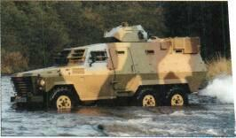 Hotspur Hussar APC (UK) KEY RECOGNITION FEATURES Vertical hull front with horizontal louvres, spare wheel on top, commander's and driver's windscreen slopes to rear with shutters hinged above,
