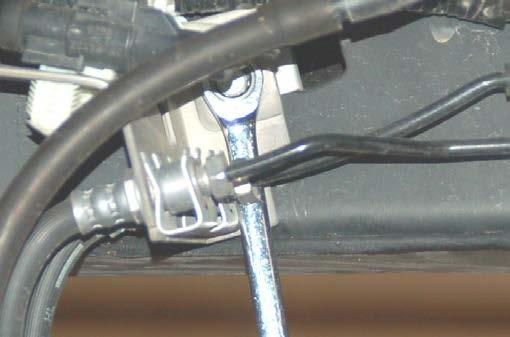 Using a 10mm wrench, remove the brake line