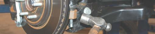 Remove tie-rod end using a 21mm wrench.