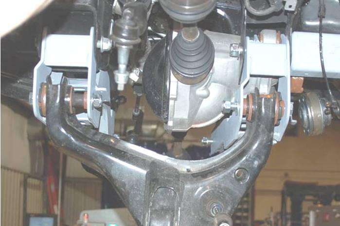 Install the front cross-member using the factory hardware.