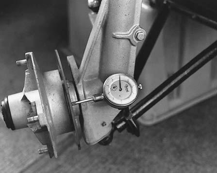 Gradually apply brakes to stop machine. Repeat procedure 10 times. Front Wheel Nut Torque 15 ft. lbs. (21 Nm) FRONT DISC INSPECTION 1. Visually inspect the brake disc for nicks, scratches, or damage.