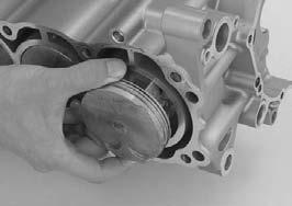 Do not try to remove the piston/connecting rod assembly from bottom of the cylinder; the assembly will get stuck in the gap between the cylinder liner and the upper crankcase.