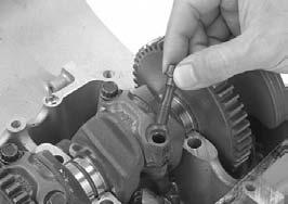 When reusing the connecting rods, they must be installed in their original locations. PISTON RING COMPRESSOR Make sure the piston ring compressor tool sits flush on the top surface of the cylinder.