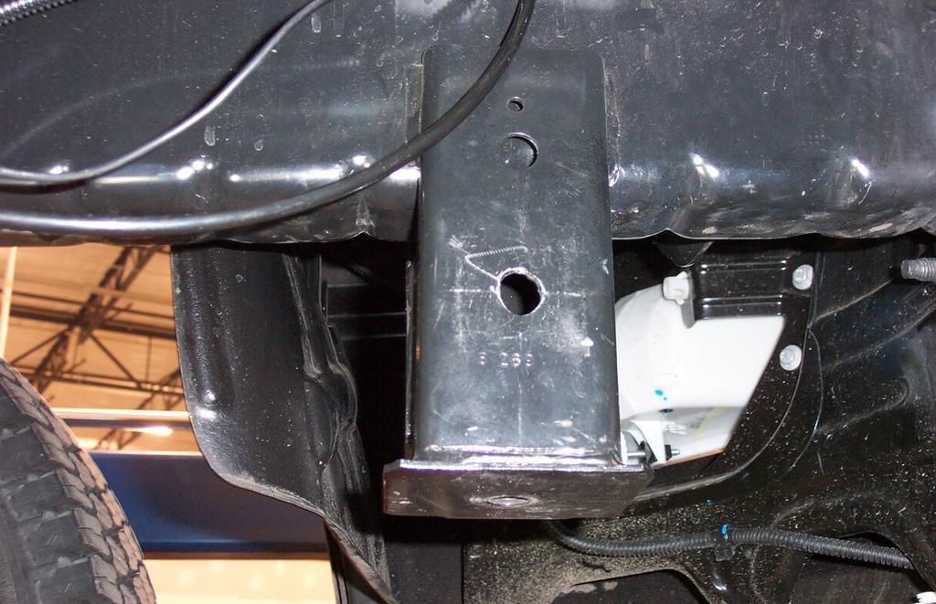 On each side, locate the tab near the bumper mounting studs (Fig.J).