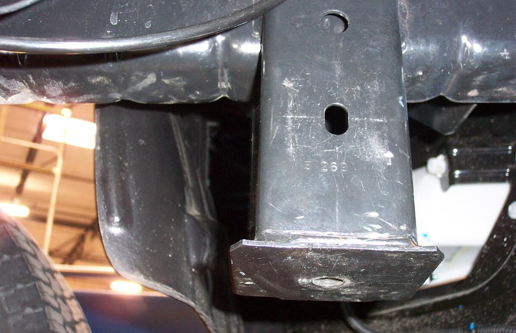 Locate the slotted opening on the inside edge of the tow hook support on each side of the
