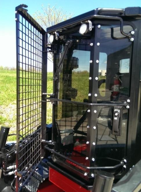 Cab Features Swing Away Brush Guard For