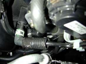 Pull the vacuum hose off of the nipple on the intake manifold
