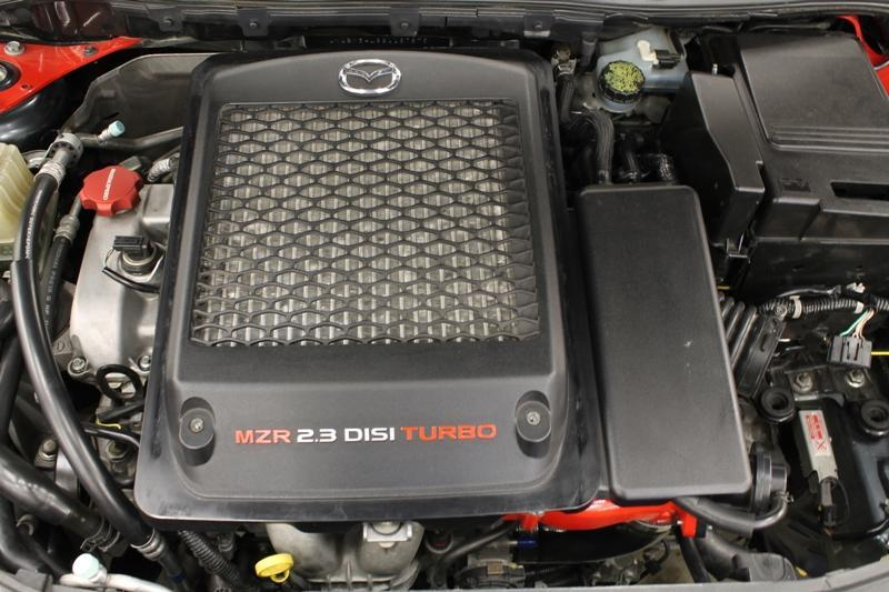 Page11 22. Remove the OEM top mounted intercooler cover using a 10mm socket.