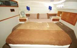 The cabins include two astonishingly large staterooms with generous island beds, and two queen aft cabins. There are two ensuites and a sizeable main bathroom with a separate shower.