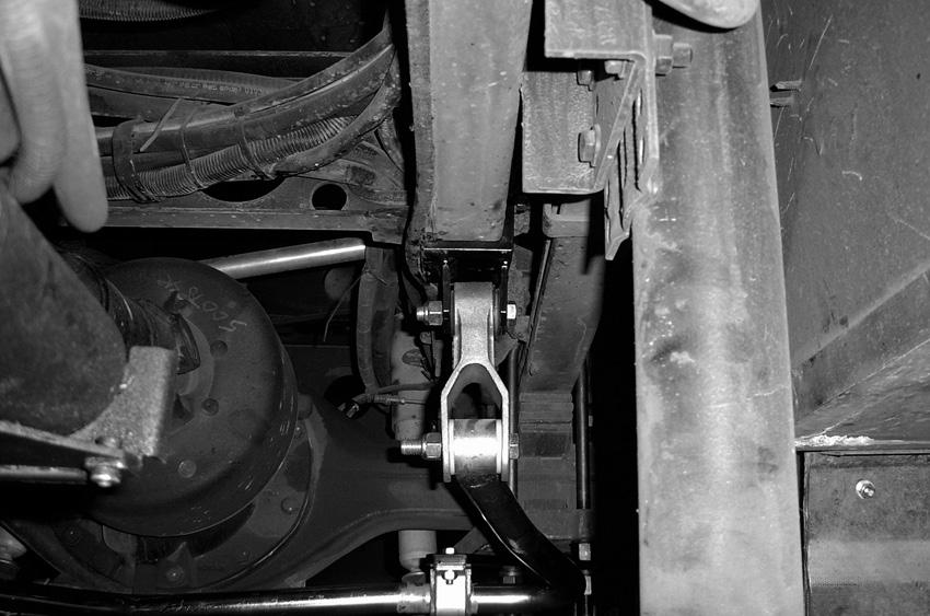 With this configuration, the bracket will mount under the axle plate and above the shock plate and facing the rear of the coach (Figure 10). 11.
