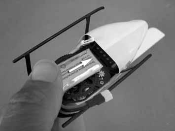 INSTALL THE FLIGHT BATTERY Slide the battery into the helicopter. Make sure the battery is slid all the way to the front of the battery tray.