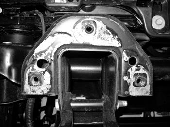 24. It is necessary to cut the front bumper frame mounts to provide clearance for the