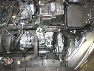Remove the upper air box and intake hose assembly from